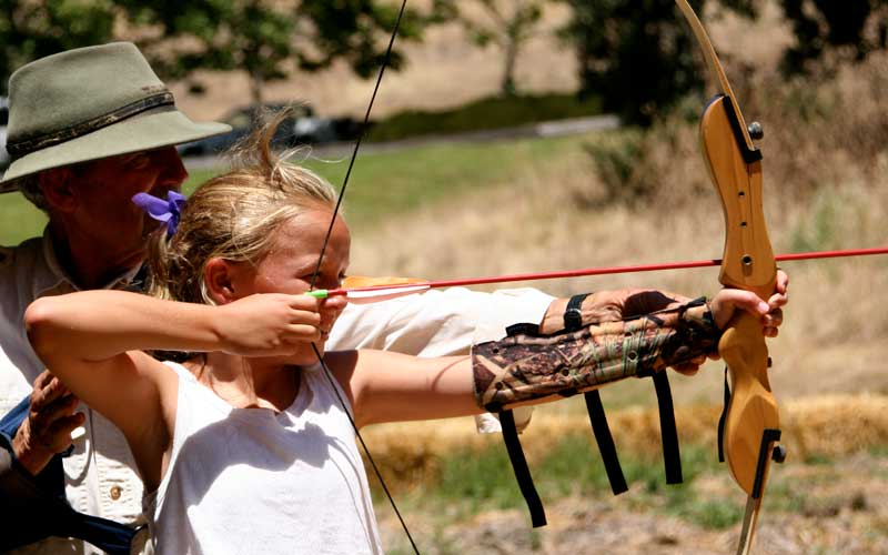 A girl shooting archery at the Alisal Guest Ranch & Resort