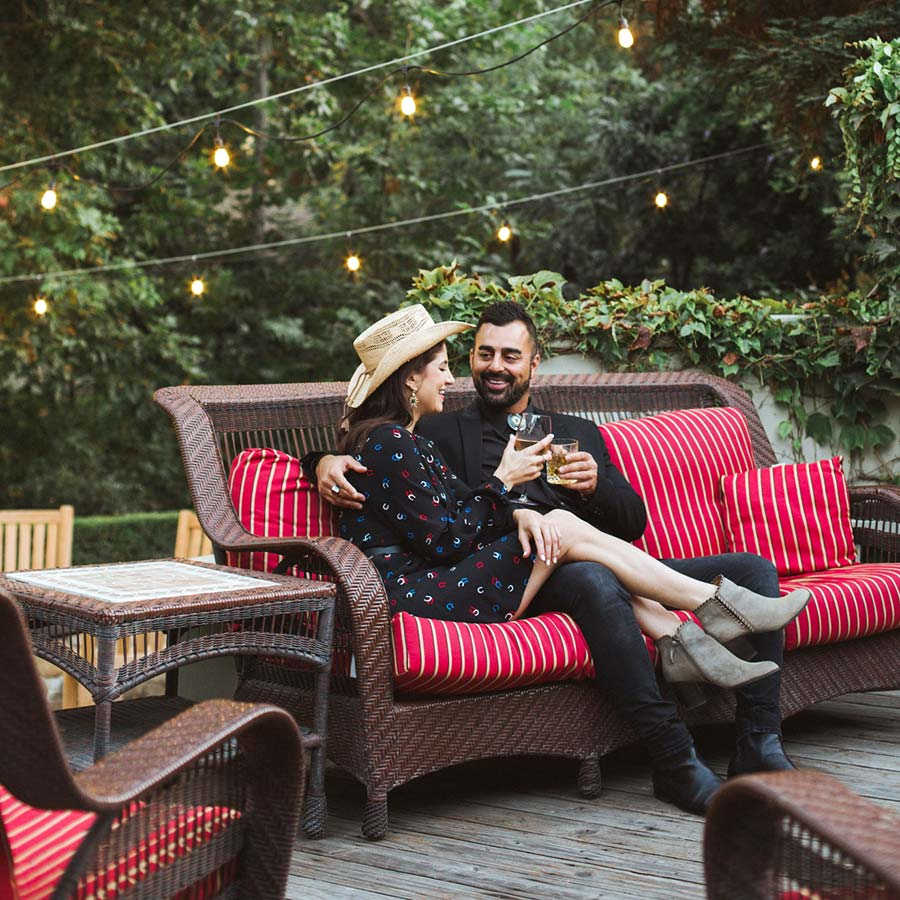 A couple enjoying wine on a private patio evening - photo credit IG@Laura_Lily