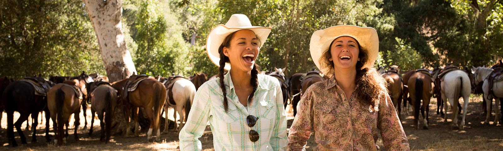 Two women laughing together on a team building event at Alisal Guest Ranch & Resort