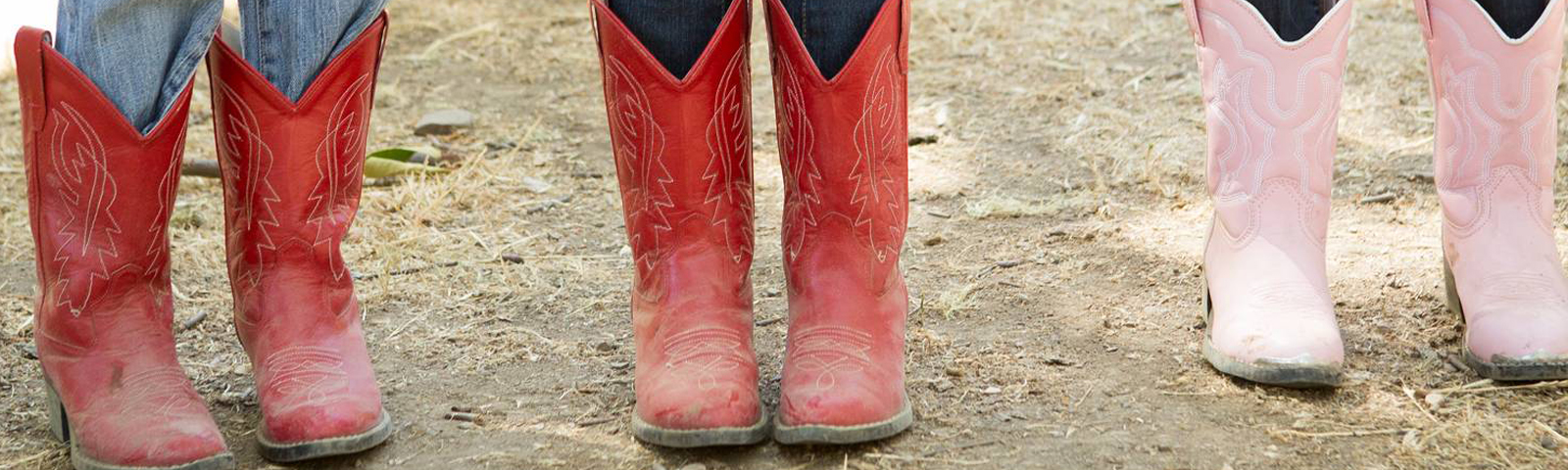 Three children's cowboy boots in red and pink