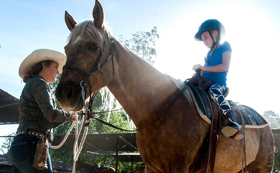 A child on horseback at the Alisal Guest Ranch in Solvang, California