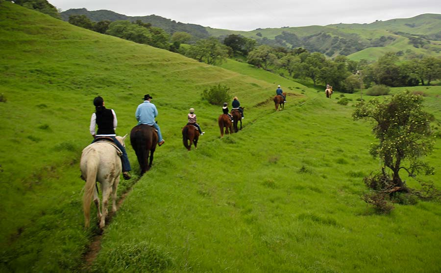 Horseback riders on the trail for the breakfast ride at the Alisal Guest Ranch & Resort