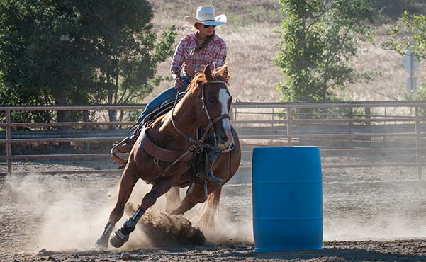 Barrel racing on horseback at the Alisal Guest Ranch & Resort