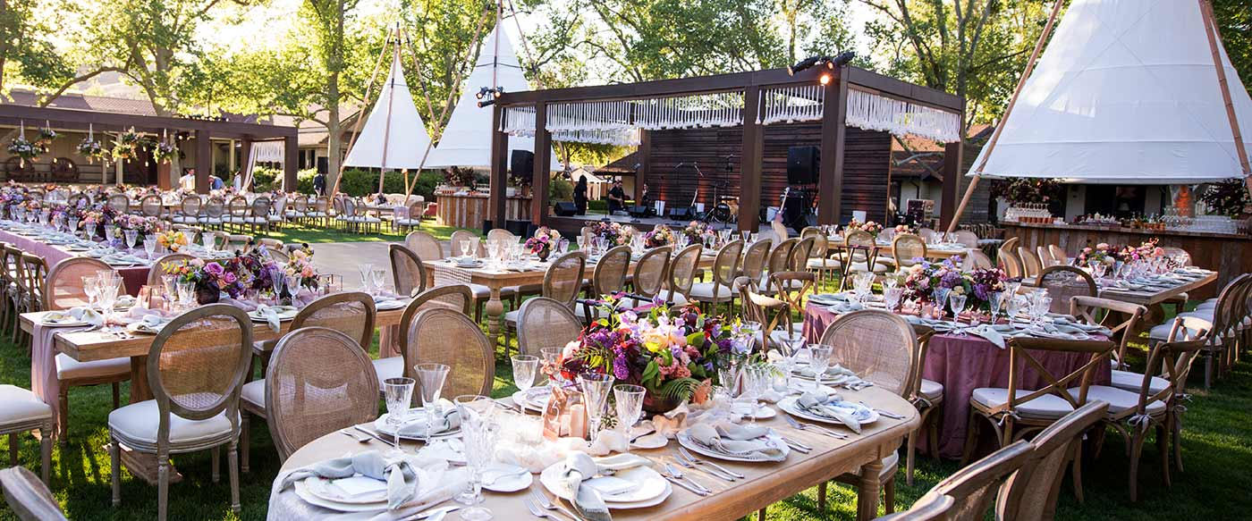 Outdoor wedding reception in the grassy oval at the Alisal Guest Ranch & Resort