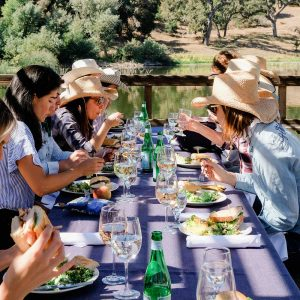 Our female guests & wranglers enjoy lunch at Alisal Lake during a women's retreat