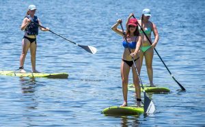 Paddle-boarding at Alisal Lake on the Saddle-to-Paddle Horseback Ride