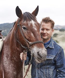 Nathan Turner, Interior Designer & Author, enjoying time with horses at the Alisal Guest Ranch & Resort
