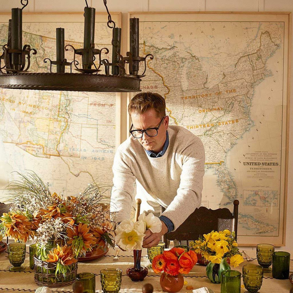 Designer Nathan Turner arranging flowers in new Luxury Suite at the Alisal